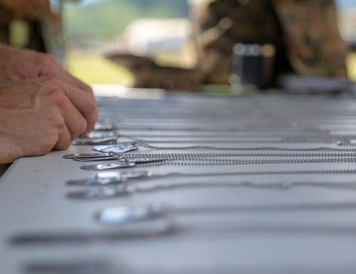 Marines organize dog tags of fallen Marines for a memorial run on Marine Corps Base Hawaii, Nov. 12, 2019. (Cpl. Eric Tso/Marine Corps)