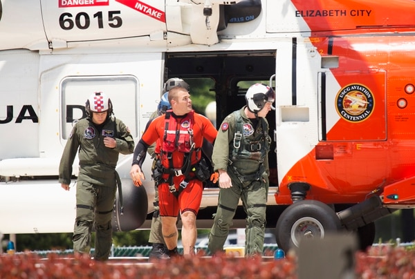 Navy aviators involved in a crash exit a coast guard helicopter at Sentara Norfolk General Hospital in Norfolk, Va. Two Navy jet fighters collided off the coast of North Carolina during a routine training mission on Thursday, sending several people to the hospital, officials said. (L. Todd Spencer/The Virginian-Pilot via AP) MAGS OUT; MANDATORY CREDIT
