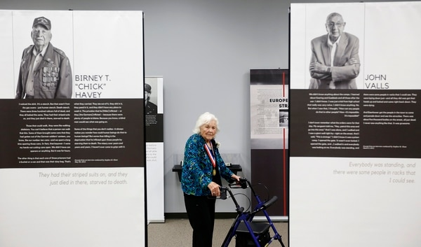 Mary Ann Lind walks through The Texas Liberator, Witness to the Holocaust, exhibit at Holocaust Museum Houston in Houston on Sept. 6, 2018. The exhibit honors American soldiers from Texas who helped liberate the concentration camps of Europe at the end of the World War II. Lind's cousin, Capt. Carroll Gustafson, was one of the soldiers to help liberate the camps. ( Brett Coomer/Houston Chronicle via AP)