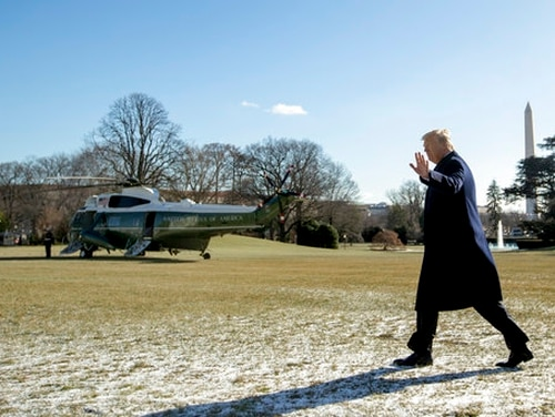 President Donald Trump waves to members of the media as he walks towards Marine One on the South Lawn of the White House on Jan. 5, 2018. (Andrew Harnik/AP)