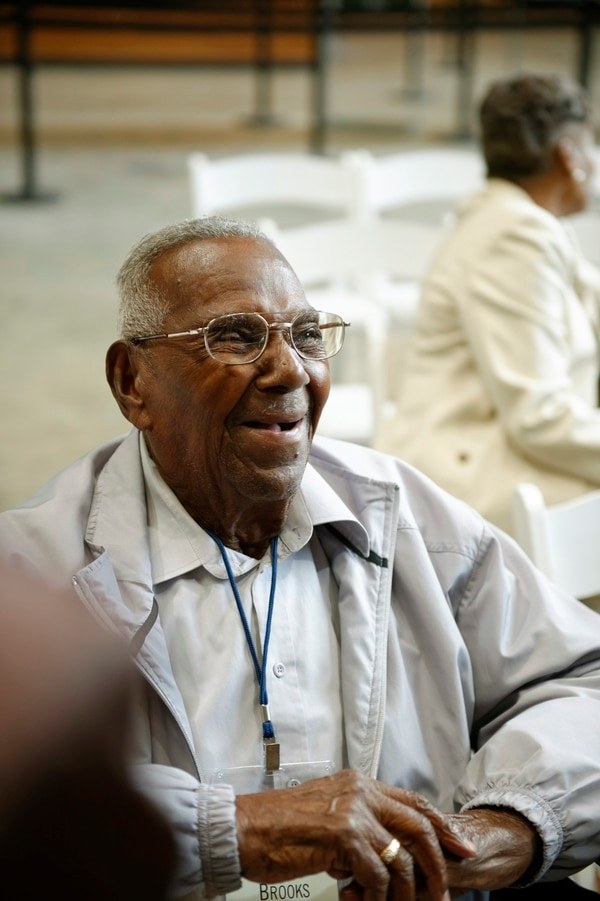 In this 2016 photo provided by The National WWII Museum, WWII veteran Lawrence Brooks celebrates his 107th birthday at the National WWII Museum in New Orleans. The National World War II Museum plans to celebrate the veteran's 108th birthday this week. The museum says Brooks' birthday is Tuesday, Sept. 12 and he'll be at the museum for cupcakes and a ceremony featuring the Victory Belles close-harmony trio. (The National WWII Museum via AP)