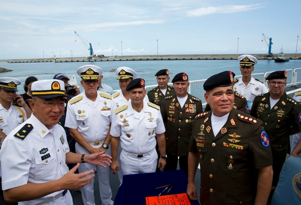 Chinese ship commander Guan Bai Lin , left corner, speaks with Venezuela's Defense Minister Vladimir Padrino, right corner as they tour the hospital ship