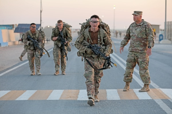 Infantry soldiers deployed in the U.S. Army Central area of operations finish a 12-mile ruck march in less than three hours as the final event in Expert Infantryman Badge testing at Camp Buehring, Kuwait on Saturday, June 1, 2019. (Sgt. Liane Hatch/Army)