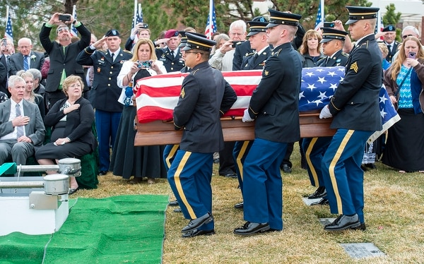 An honor guard carries the casket of 2nd Lt. Lynn W. Hadfield during funeral services at Veterans Memorial Park in Bluffdale, Utah, Thursday. (Rick Egan/The Salt Lake Tribune via AP)