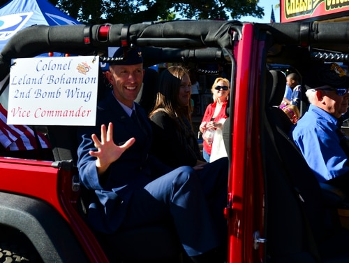 Col. Leland Bohannon, then-2nd Bomb Wing vice commander, waves at a crowd during the 2014 Veterans Day parade at Shreveport, La., Nov. 9, 2014. (Airman 1st Class Mozer Da Cunha/Air Force)