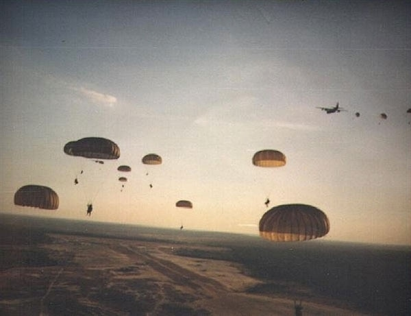 Rangers parachute into battle during Operation Urgent Fury. (Photo by Department of Defense)