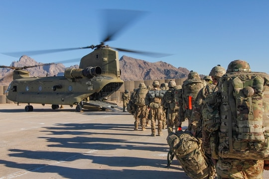 Soldiers load onto a Chinook helicopter to head out and execute missions across the Combined Joint Operations Area- Afghanistan. (Army)