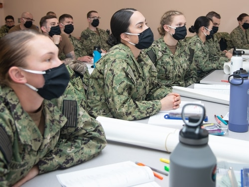 Naval Science Institute Seaman to Admiral-21 students at Officer Training Command Newport, R.I., listen during a class on compasses and navigational equipment. (MC2 Derien Luce/Navy)