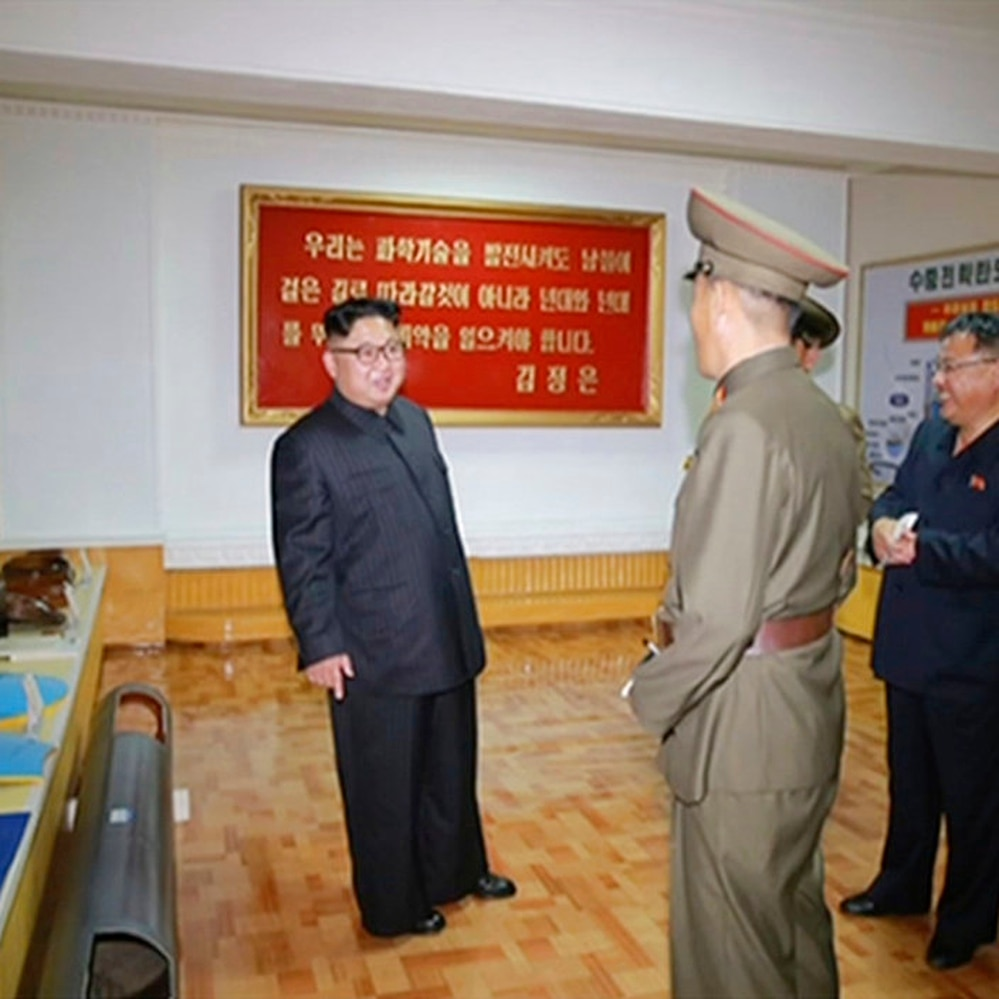 North Korean leader Kim Jong Un visits the Chemical Material Institute of Academy of Defense Science at an undisclosed location in North Korea. North Korea's state media released photos that appear to show concept diagrams of the missiles hanging on a wall behind Kim, one showing a diagram for a missile called Pukguksong-3. (KRT via AP)