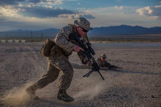 Lance Cpl. Seth Levine bounds forward during a simulated exercise of clearing a trench during Integrated Training Exercise 4-19 aboard the Marine Corps Air Ground Combat Center, Twentynine Palms, Calif., June 5, 2019. (Lance Cpl. Preston L. Morris/Marine Corps)