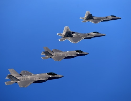 F-22 Raptors and F-35 Lightening II jets fly in formation over the Eglin Training Range after completing an integration training mission. (Master Sgt. Shane A. Cuomo/U.S. Air Force)