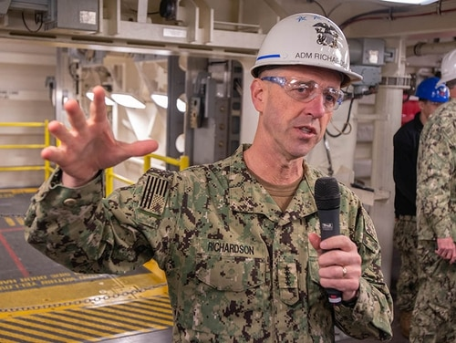 Chief of Naval Operations Adm. John Richardson talks to the media in front of one of the the Ford's new weapons elevators. (Mark D. Faram/Staff)