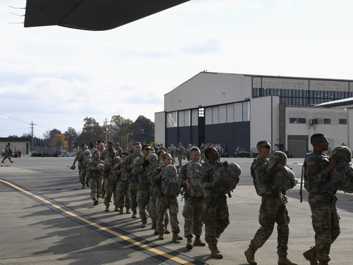 Soldiers from the 591st Military Police Company board a C-130J Super Hercules Oct. 31, 2018, at Ft. Knox, Ky. The 591st Military Police Company is deploying soldiers, equipment and resources to assist Department of Homeland Security along the southwest border. (Airman First Class Daniel A. Hernandez/Air Force)