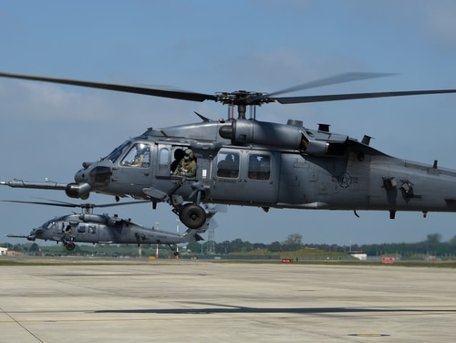 Two HH-60G Pave Hawks prepare to depart from the flightline during a farewell event for the 56th Rescue Squadron at Royal Air Force Lakenheath, England, May 15, 2018. (Staff Sgt. Alex Fox Echols III/Air Force)
