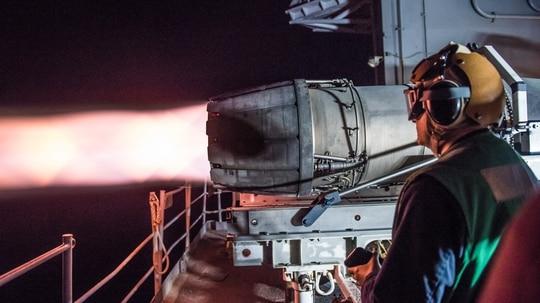 A sailor from USS John C. Stennis (CVN 74) observes a test of a jet engine on the ship's fantail. John C. (Mass Communication Specialist 2nd Class Luke Moyer/Navy)
