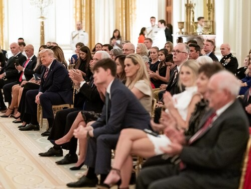 President Donald Trump, Vice President Mike Pence and dozens of guests listen as songs are sung at a remembrance candle lighting during a reception to honor Gold Star families on Sept. 27, 2020, in the East Room of the White House. (White House)