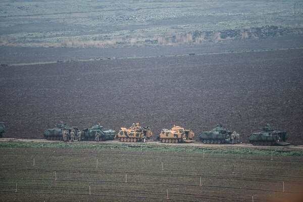 Turkish tanks are parked near the Syrian border at Hassa, Hatay province, on Jan. 24, 2018, as part of an operation to oust the YPG militia, which Turkey considers to be a terrorist group, from its enclave of Afrin. (Ozan Kose/AFP via Getty Images)