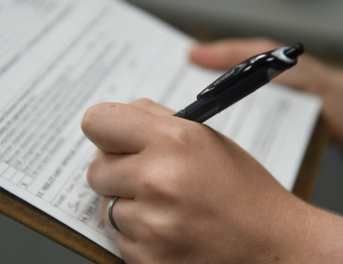 A spouse at Dyess Air Force Base in Texas applies for reimbursement of costs for professional relicensing after a PCS move. (Senior Airman Susan Roberts/Air Force)