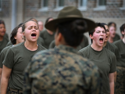 Drill Instructor SSgt. Jennifer Garza disciplines her Marine recruits with some unscheduled physical training in the sand pit outside their barracks during boot camp February 27, 2013 at MCRD Parris Island, South Carolina. (Scott Olson/Getty Images)