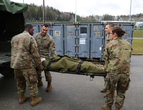 Soldiers assigned to the 115th Field Hospital prepare a patient for transportation at the Hohenfels Training Area in Germany on March 3, 2020. (Pfc. Ravenne Eschbach/Army)