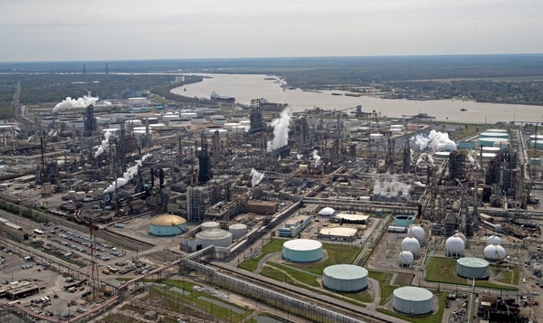 This March 8, 2018, photo, shows the Shell Norco oil refinery along the Mississippi River in Norco, La. The FBI is keenly aware of the dangers that cyber-criminals pose to Mississippi River-related businesses and south Louisiana infrastructure. And the agency wants the public at large to be aware, as well. (Gerald Herbert/AP)