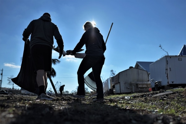 Tech. Sgt. Jordan Mcguirt and his wife Rebecca clean debris from Under the Palms Park in Mexico Beach, Fla., Dec. 16, 2018. Thirty nine volunteers from Tyndall and Eglin Air Force Bases came together to help clean Mexico Beach, one of the communities hit the hardest by Hurricane Michael. (Tech. Sgt. Sara Keller/Air Force)