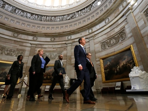 From left, Rep. Val Demings, D-Fla., Rep. Rep. Zoe Lofgren, D-Calif., Rep. Hakeem Jeffries, D-N.Y., House Intelligence Committee Chairman Adam Schiff, D-Calif., and House Judiciary Committee Chairman, Rep. Jerrold Nadler, D-N.Y., walk through the Capitol building to the Senate to deliver the articles of impeachment against President Donald Trump on Jan. 16, 2020. (Julio Cortez/AP)