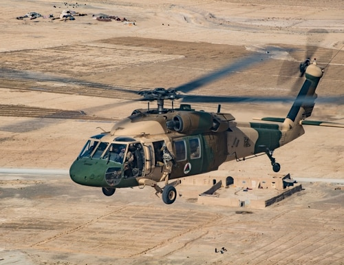 An Afghan Air Force UH-60 Black Hawk, piloted by an Afghan and American pilot, flies in formation Dec. 8, 2018, while participating in the NATO led Resolute Support mission in Afghanistan. (Staff Sgt. Clayton Cupit/Air Force)
