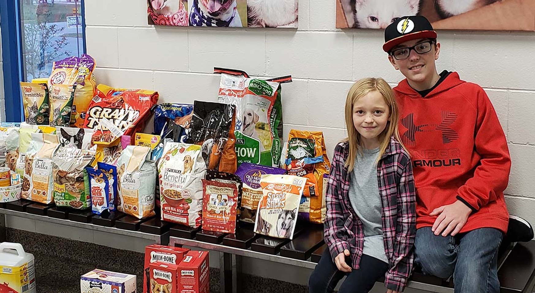 Jaxson Jordan and his sister with pet food donations. (Operation Homefront)