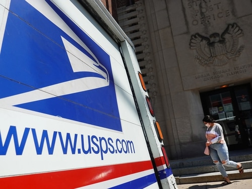 A postal vehicles sits in front of a United State Postal Service facility on Aug. 13, 2020, in Chicago. (Scott Olson/Getty Images)