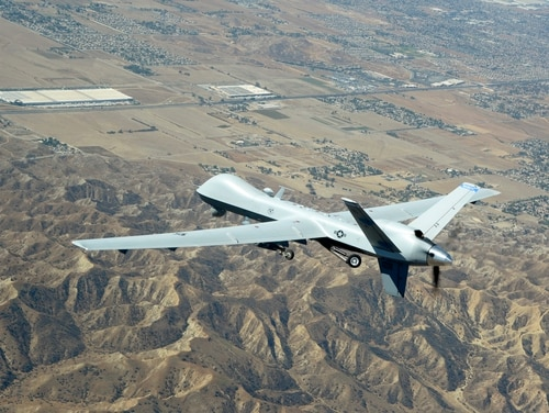An MQ-9 Reaper remotely piloted aircraft assigned to the 163d Attack Wing soars over Southern California skies on a training flight to March Air Reserve Base, California, on Sept. 15, 2016. (Tech. Sgt. Neil Ballecer/Air National Guard)