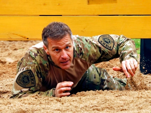 In this April 22, 2017 photo, then-Missouri Gov. Eric Greitens crawls under an obstacle during the SEMO SWAT Challenge in Fredericktown, Mo. (Jacob Scott/Daily Journal via AP)