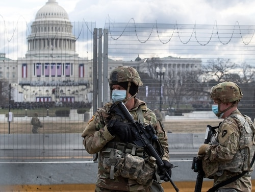 National Guard troops patrol the grounds of the U.S. Capitol building hours before the inauguration of President Joe Biden on Jan. 20, 2021. (Roberto Schmidt/AFP)