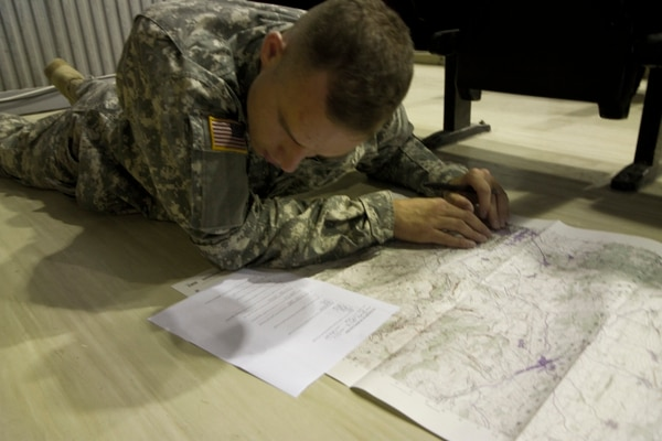 U.S. Army Sgt. Sterling Quimby, from 1st Battalion, 169th Aviation Regiment and assigned to Multinational Battle Group-East, plots the grid coordinates on the map during the land navigation portion of the MNBG-E Soldier of the Month competition, August 1, 2015, at Camp Bondsteel, Kosovo. The competition, held by Command Sgt. Maj. Ralph Johnson, the senior noncommissioned officer for the North Carolina National Guard's 30th Armored Brigade Combat Team as well as MNBG-E, was broken into two categories, one for junior enlisted Soldiers and another for sergeants and staff sergeants. The day led off early that morning with an Army Physical Fitness Test, followed by a day of challenges that measured the Soldiers' knowledge of land navigation, first aid, detainee operations and military customs. (U.S. Army photo by Sgt. Erick Yates, Multinational Battle Group-East)