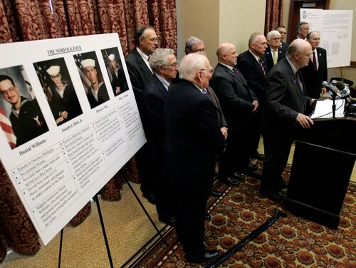 Retired FBI agent Jay Cochran, at podium, speaks during a news conference on the murder convictions of the Norfolk Four in Richmond, Va., Monday, Nov. 10, 2008. Cochran was joined by other retired FBI agents in asking the Governor to grant pardons for the four sailors convicted of raping and killing an 18-year-old Norfolk woman in 1997. (AP Photo/Steve Helber)