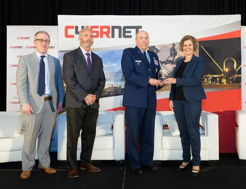 Members of the Information Technology Investment Portfolio Suite (ITIPS), the winners of the C4ISRNET Software Management award, accepting at the 17th annual C4ISRNET conference.