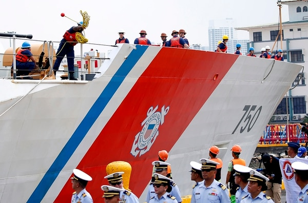 A crew of the U.S. Coast Guard National Security Cutter Bertholf (WMSL 750) throws a line as it arrives for a port call in the first visit by a U.S. cutter in over seven years, Wednesday, May 15, 2019 in Manila, Philippines. (Bullit Marquez/AP)