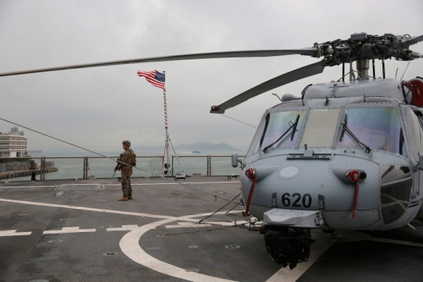 A U.S. marine patrols on the deck of the Blue Ridge, the 7th Fleet flagship, during a port call in Hong Kong on Saturday. (Kin Cheung/AP)