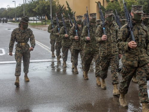 Recruits begin taking extra precautions to prevent the spread of COVID-19 by wearing face masks at Marine Corps Recruit Depot, San Diego, April, 9, 2020. ( Lance Cpl. Zachary T. Beatty/ Marine Corps)