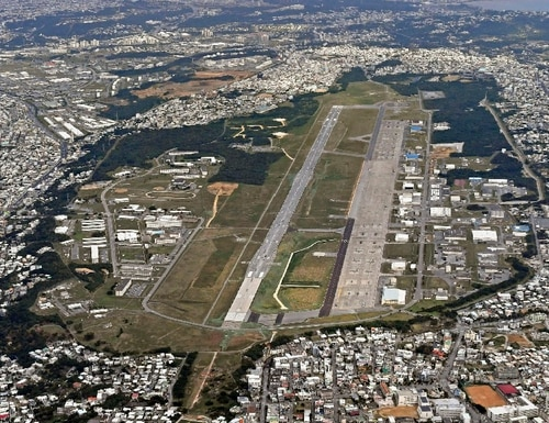 This Jan. 27, 2018 aerial photo shows U.S. Marine Air Station Futenma in Ginowan, Okinawa, southern Japan. The election of an outspoken critic of the American military presence in Okinawa throws into question plans for a new U.S. air base on the island and possibly the future of all the facilities there. (Kyodo News via AP)