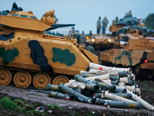 Turkish soldiers prepare their tanks to enter combat and join a military offensive on a Kurdish-held enclave in northern Syria, at a staging area in the Hatay province,Turkey near the the border with Syria. The operation codenamed Olive Branch is on its fourth day. (Lefteris Pitarakis/AP)