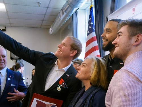 Spencer Stone takes a selfie with, from left, French Conseillere Consulaire Sophie Lartilleux-Suberville, Anthony Sadler and Alek Skarlatos following a French Naturalization Ceremony in Sacramento, Calif., Jan. 31. The three men were heralded as heroes when they subdued an armed terrorist on a train in France in 2015. (Randall Benton/AP)