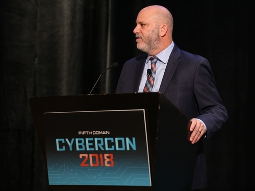 Deputy Assistant Secretary at the Office of Cybersecurity and Communications Richard Driggers speaks about changing the name of the National Protection and Programs Directorate at the CyberCon event hosted by Fifth Domain at the Ritz-Carlton Pentagon City on Nov. 1, 2018. (Jillian Angeline/Staff)