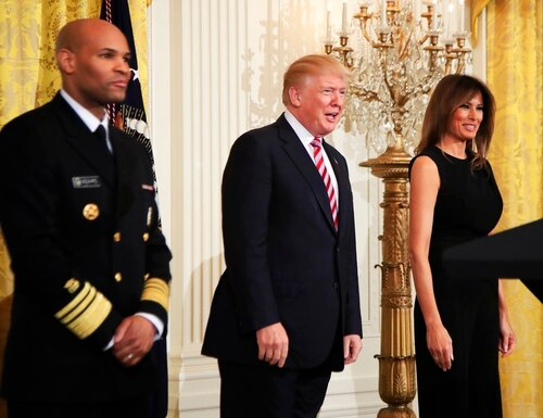 President Donald Trump, center with first lady Melania Trump and Surgeon General Jerome Adams, left, speaks during a National African American History Month reception in the East Room of the White House, Tuesday, Feb. 13, 2018, in Washington. (Manuel Balce Ceneta/AP)