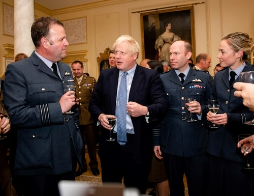 Britain's Prime Minister Boris Johnson (C) talks with members of Britain's military during a reception for the Armed Forces inside 10 Downing Street in Central London on September 18, 2019. (Photo by JOHN NGUYEN/AFP via Getty Images)