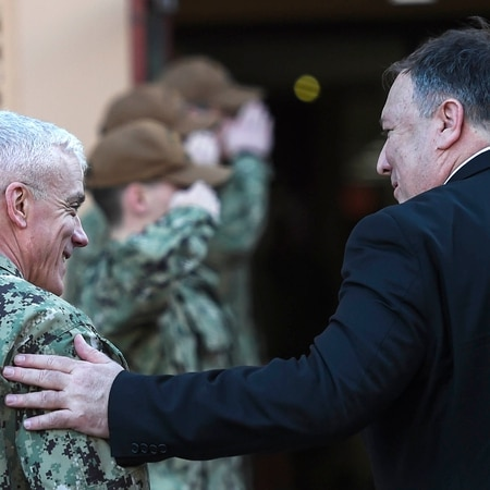 US Secretary of State Mike Pompeo, right, talks with Vice Admn. James Malloy, commander of U.S. Naval Forces, U.S. Central Command. (Andrew Caballero-Reynolds/AFP)