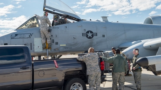 Members of Combat Shield from the 16th Electronic Warfare Squadron conduct an assessment of an A-10 Thunderbolt II with airmen from the 124th Fighter Wing, May 9, 2019, Gowen Field, Boise, Idaho. Combat Shield annually assess electronic warfare readiness for all combat Air Force wings. (Ryan White/U.S. Air National Guard)