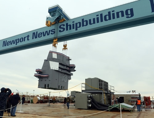 The 555-metric ton island for the future nuclear-powered aircraft carrier USS Gerald R. Ford (CVN 78) is lifted into position on the ship's flight deck during an island landing ceremony at Huntington Ingalls Industries-Newport News Shipbuilding on Jan. 26, 2013, in Newport News, Va. (MC3 Sabrina Fine/Navy)