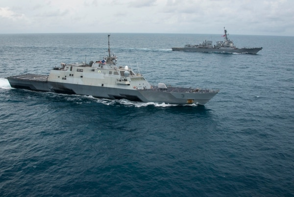The littoral combat ship USS Fort Worth (LCS 3), left, and the guided missile destroyer USS Sampson (DDG 102), operate together in the Java Sea while supporting the Indonesian-led search effort for AirAsia flight QZ8501. MC1 Brett Cote/US Navy.