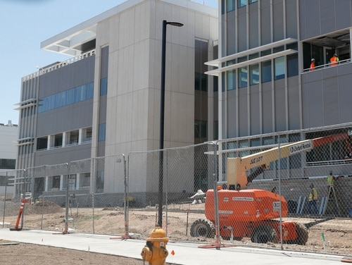 Contractors work on one of the buildings on the campus of the Aurora, Colo., Veterans Affairs hospital on June 8, 2017. (David Zalubowski/AP)